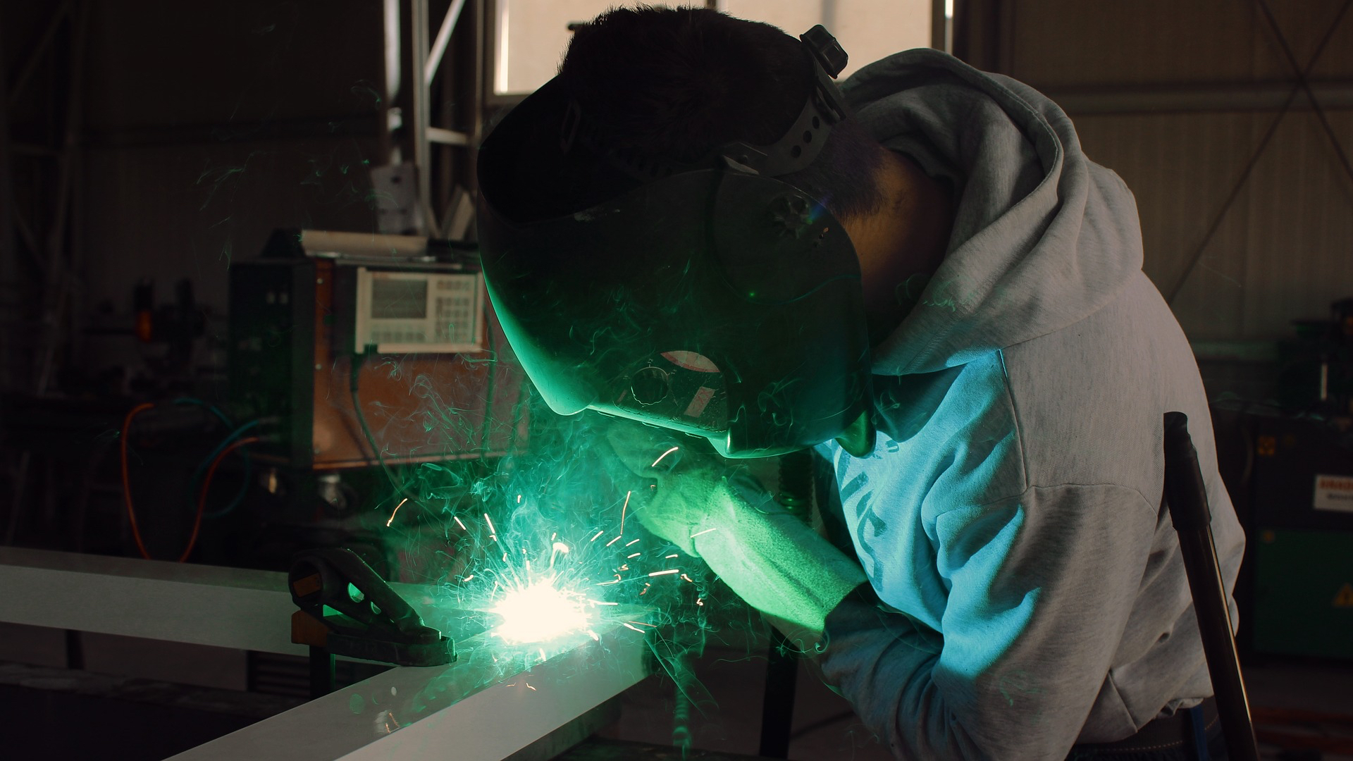 Man performing welding in workshop